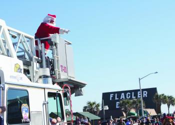 Santa rode on a fire truck Saturday, Dec. 4, to assess chimney sizes during the Flagler Beach Holiday Parade. PHOTO BY BRIAN MCMILLAN