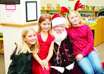 Kalie, Lauren and Nicole Januszkiewicz tell Santa what they want for Christmas. PHOTOS BY SHANNA FORTIER