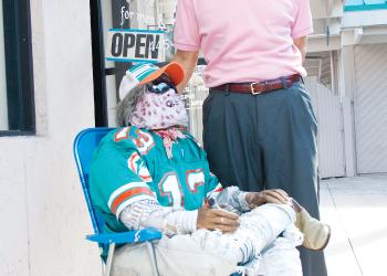 Guy and doll: Terry Conley dressed his dummy in a Miami Dolphins jersey to celebrate football season. PHOTO BY BRIAN MCMILLAN