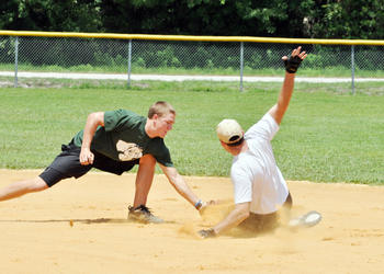 Joe O'Brien, shortstop for Fox Landscaping, tags out Rod Long, of Flagler Coed, at second base. PHOTOS BY SHANNA FORTIER