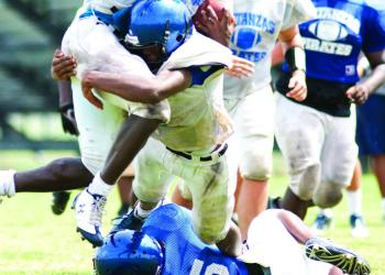 Tyrique Harper, MHS senior wide receiver, fights for yards at practice