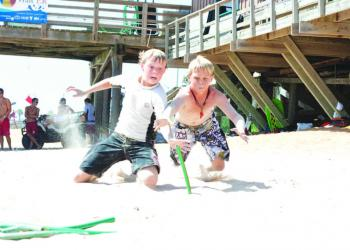 Brothers Hayden and Evan Ore do battle over beach flags, a Flagler Beach Junior Lifeguard game, in preparation for the competition in Jacksonville Beach. The Flagler Beach program took home 37 medals from the July 24 competition