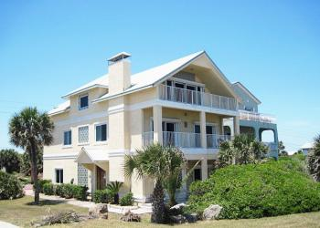 This bank-owned Oceanshore Boulevard home sold for $510,000. COURTESY PHOTO