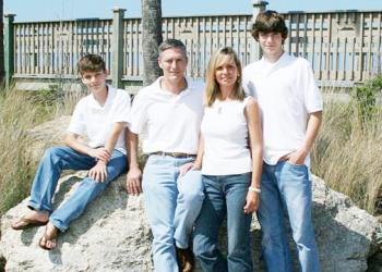 Jay Gardner poses with his wife, Lisa, and his sons, James and Adam.
