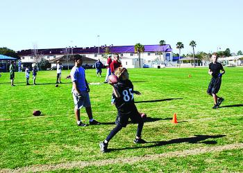 Evan Gentry, 10, competes in the punt, pass and kick contest Jan. 8, on registration day of the new Phantom Flag Football league. COURTESY PHOTO