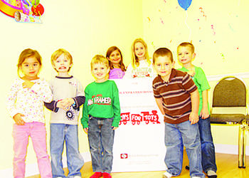 Brayden Landi (front row, far right) and guests at his birthday party were excited to donate toys to children in need. COURTESY PHOTO
