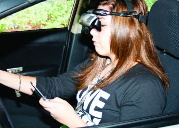 Mariah Nava, 16, learns the effects of texting and driving, at the Arrive Alive Tour stop at Flagler Palm Coast High School. PHOTO BY SHANNA FORTIER