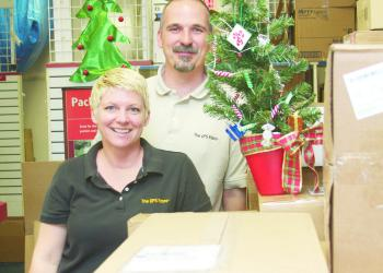 Wendy and Jerry Eggert said their Monday shipping volume triples in December, compared to the rest of the year. They've owned The UPS Store for 11 years. PHOTO BY BRIAN MCMILLAN
