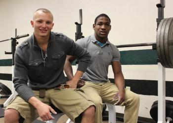 Flagler Palm Coast weightlifters Carl Lilavois (left) and Marcus Polite suffered defeat last season. That sting has left them motivated this season. (Andrew O'Brien)