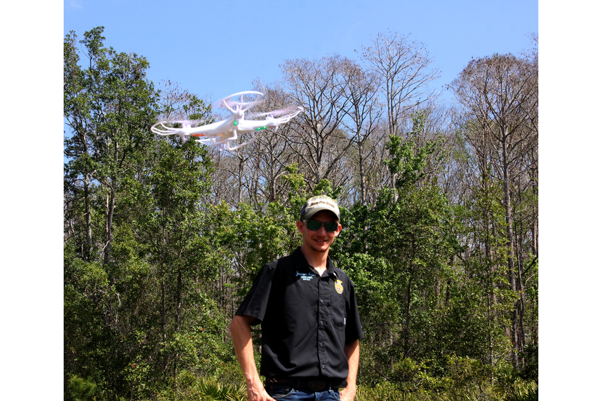 FPC student Jaxon Cox watch a drone being flown by fellow FPC student Michael Akialis. Photo by Jacque Estes