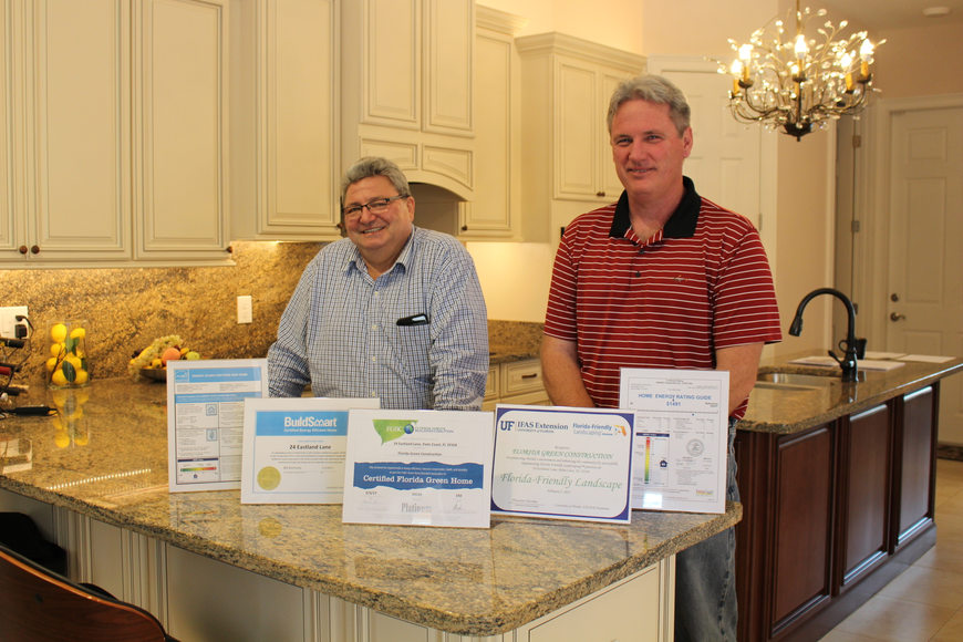 Gene Slone (left) and Jeff Vasilevskiy of Florida Green Construction in front of their new green model home. Courtesy photo