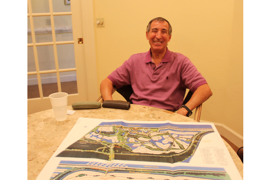 Hammock Dunes HOA President George De Govanni sits in front of a map of Hammock Dunes. The 2.3 miles of beach-front dunes were destroyed by Hurricane Matthew. Photo by Jacque Estes