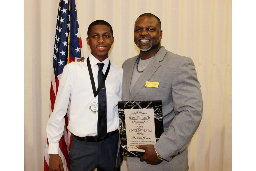 Carl Jones (pictured with Ally Louis-Charles) won the AAMP Mentor of the Year Award. Photo by Jeff Dawsey