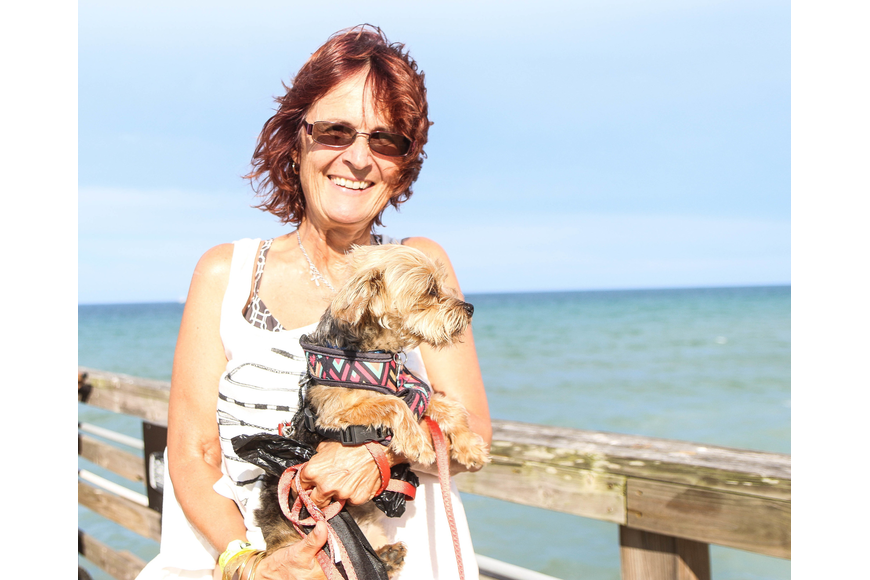 Palm Coast resident Olga Copson and her dog Typo enjoy the festivities. Photo by Paige Wilson