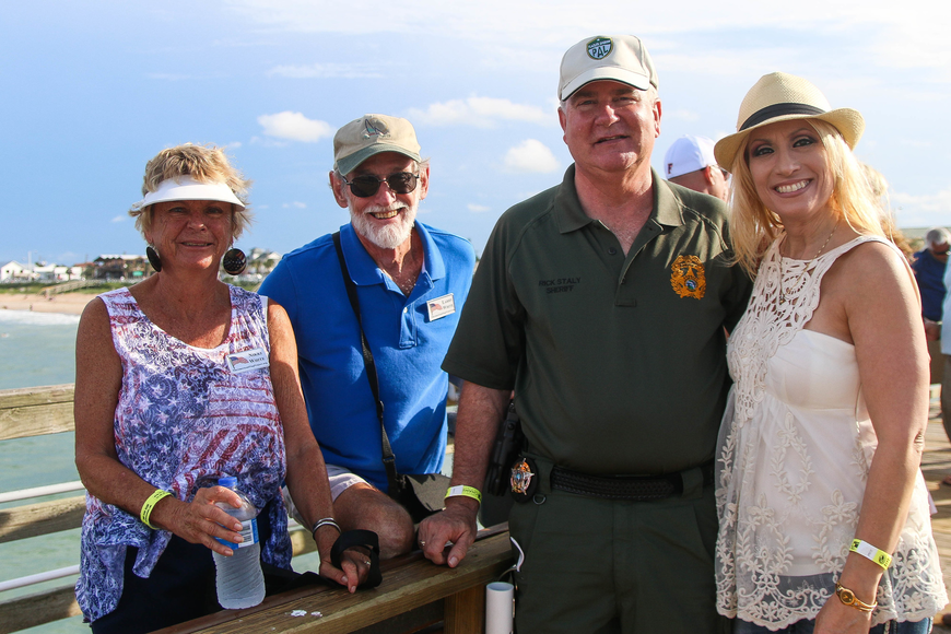 Nikki and Larry White stand with Flagler Sheriff Rick Staly and Debbie Staly. Photo by Paige Wilson