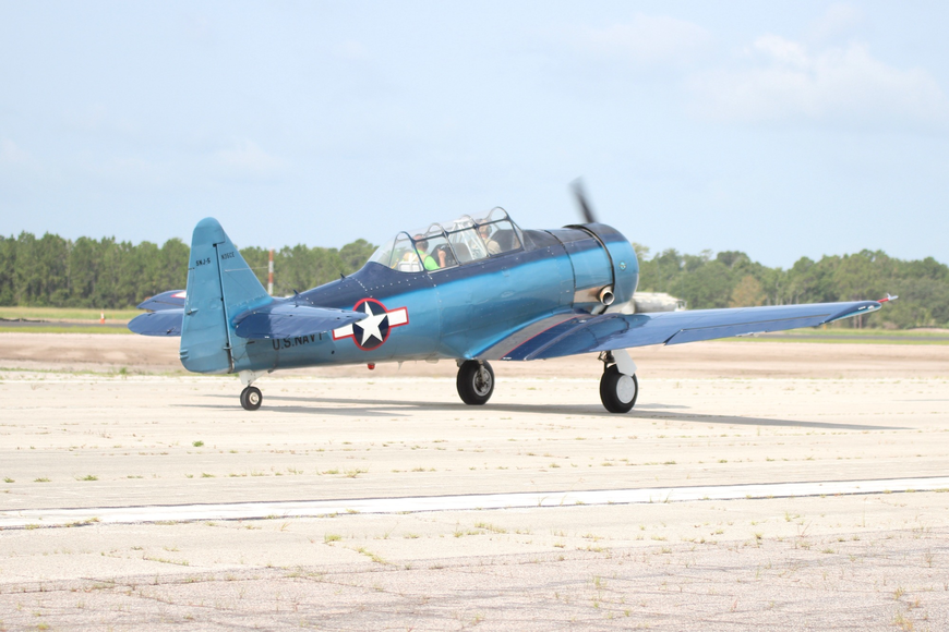 Pilot Jon Rising's World War II era T-6  Texan begins to pick up speed for takeoff on Runway 11-29 at Flagler Executive Airport. Photo by Ray Boone