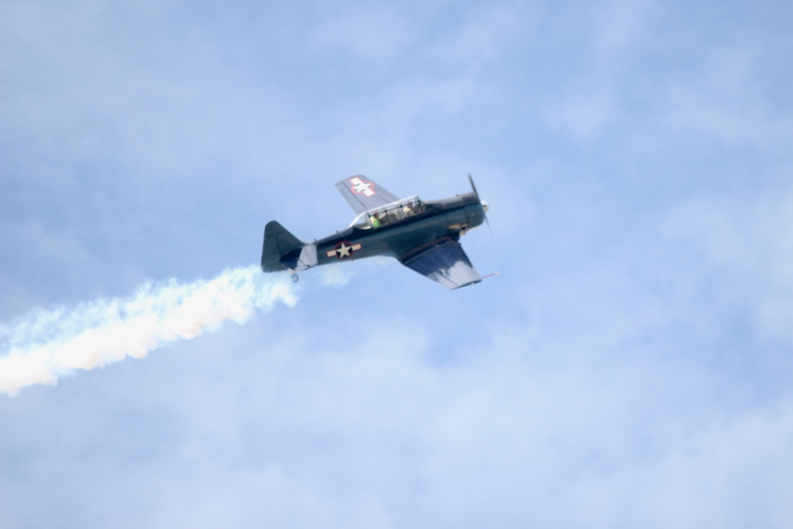 The experience was marked by a smoke stream as pilot Jon Rising flew his T-6 Texan over Runway 11-29. Photo by Ray Boone