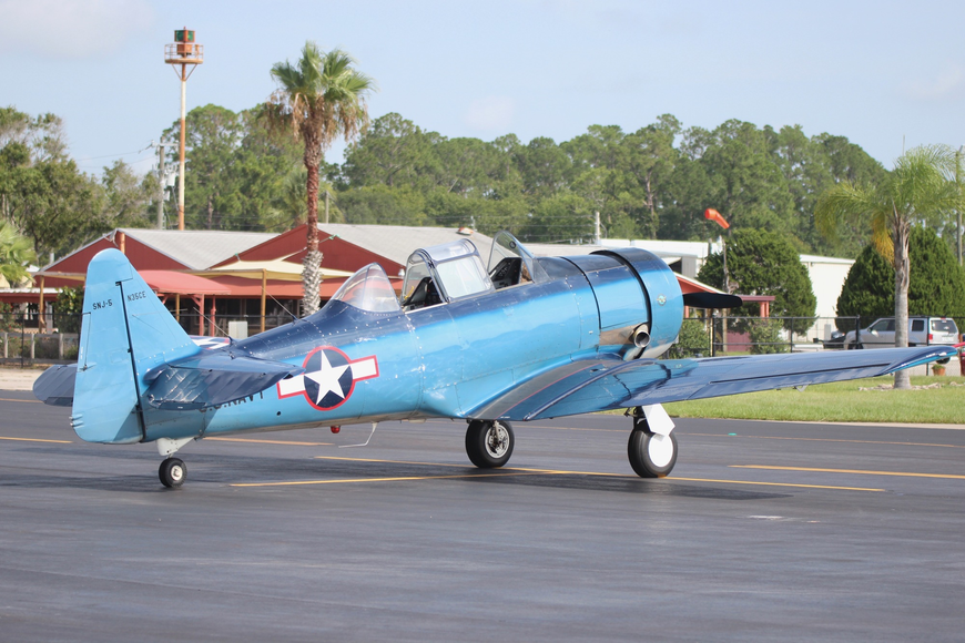 JetBlue pilot Jon Rising's T-6 Texan, an aircraft that was used to train pilots during World War II, sits idle before takeoff. Photo by Ray Boone
