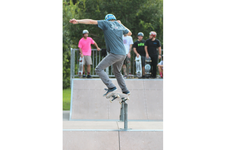 Aaron McCombs grinds across a rail at Ralph Carter Park. McCombs is a member of the Maui Nix skate team. Photo by Ray Boone