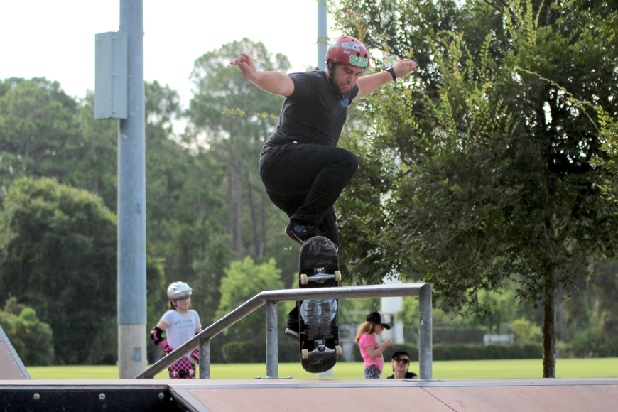 Maui Nix skater Dylan O'Keefe grinds across a rail at Ralph Carter Park. Photo by Ray Boone