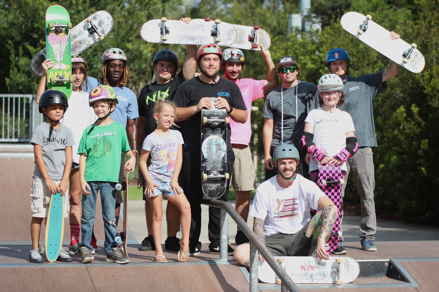 Kids from around Palm Coast and members of the Maui Nix skate team pose for a photo at Ralph Carter Park. Photo by Ray Boone