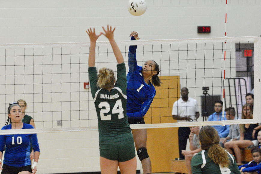 Matanzas hitter Jaelyn Lawrence goes for a kill over an FPC blocker. Photo by Ray Boone