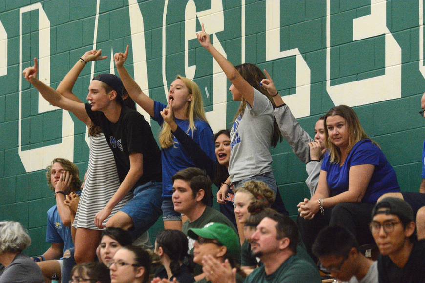 Matanzas fans cheer in the stands at Flagler Palm Coast High School as their team begins to rally. Photo by Ray Boone
