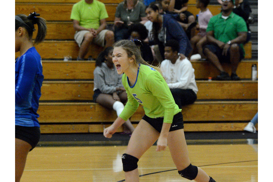 Matanzas libero Savannah Evans celebrates after her team scores a point. Photo by Ray Boone