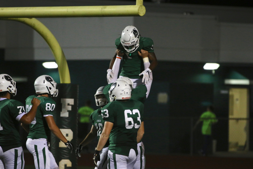 FPC running back Jimmie Robinson celebrates with his teammates after scoring a touchdown. Photo by Ray Boone