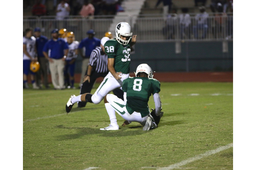 FPC kicker Samuel Petrin attempts an extra point. Photo by Ray Boone