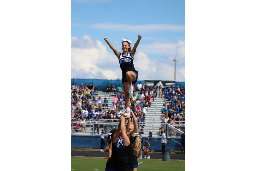 Matanzas cheerleader Alessandra Robinson pumps up the crowd during the homecoming pep rally. Courtesy photo by Alyssa Kemper