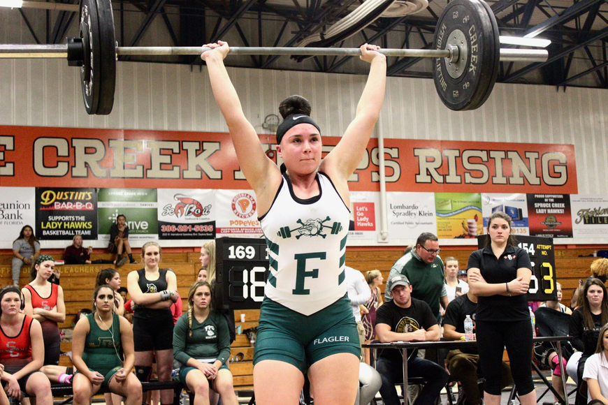 FPC's Anisa Zwolinski clean-and-jerks at the Bulldogs' regional. Photo by Ray Boone