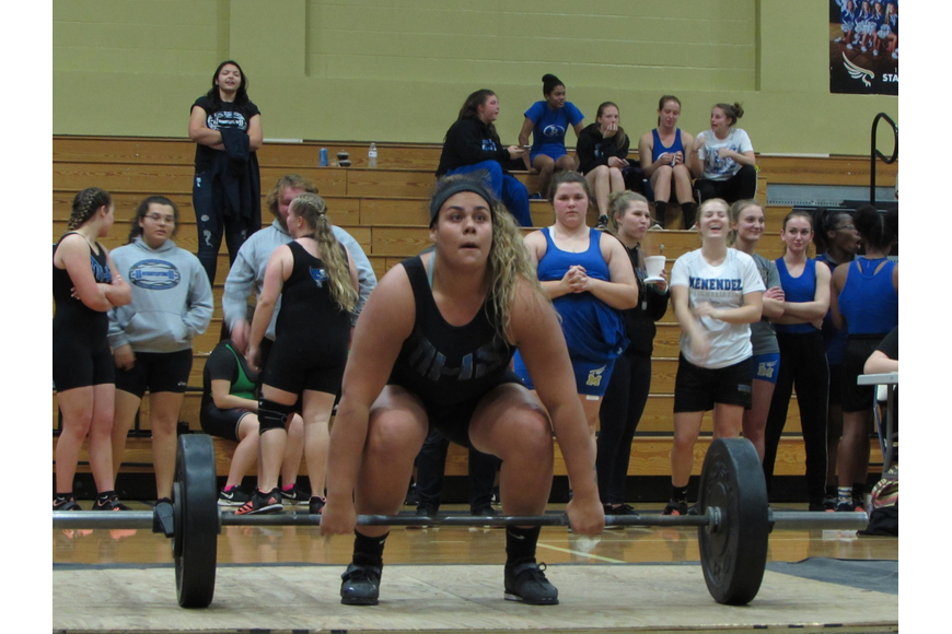 Matanzas' Chiara Longo clean-and-jerks at the Pirates' regional meet. Photo courtesy of Sierra Luther