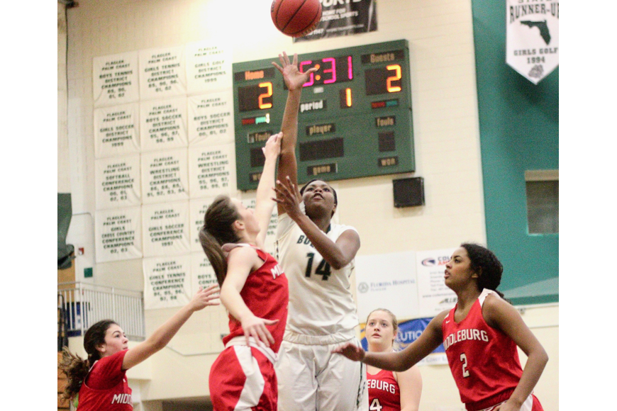 Bulldogs forward Skye Green shoots a floater against the Broncos' defense. Photo by Ray Boone