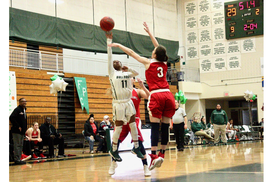 FPC guard Dyman Howard shoots a floater against Middleburg. Photo by Ray Boone