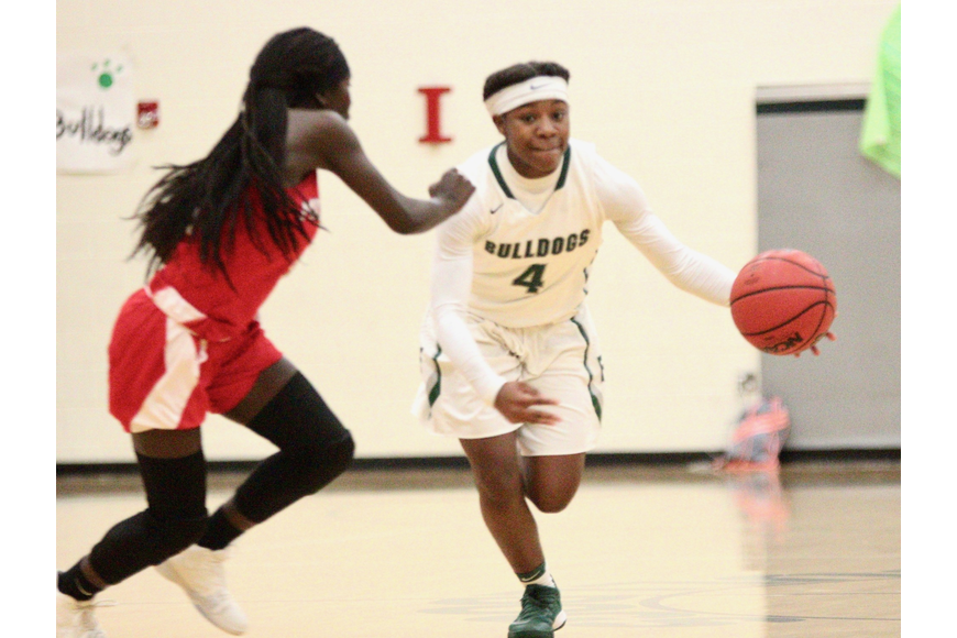 FPC guard Jimaya Baker drives down the court against the Broncos. Photo by Ray Boone