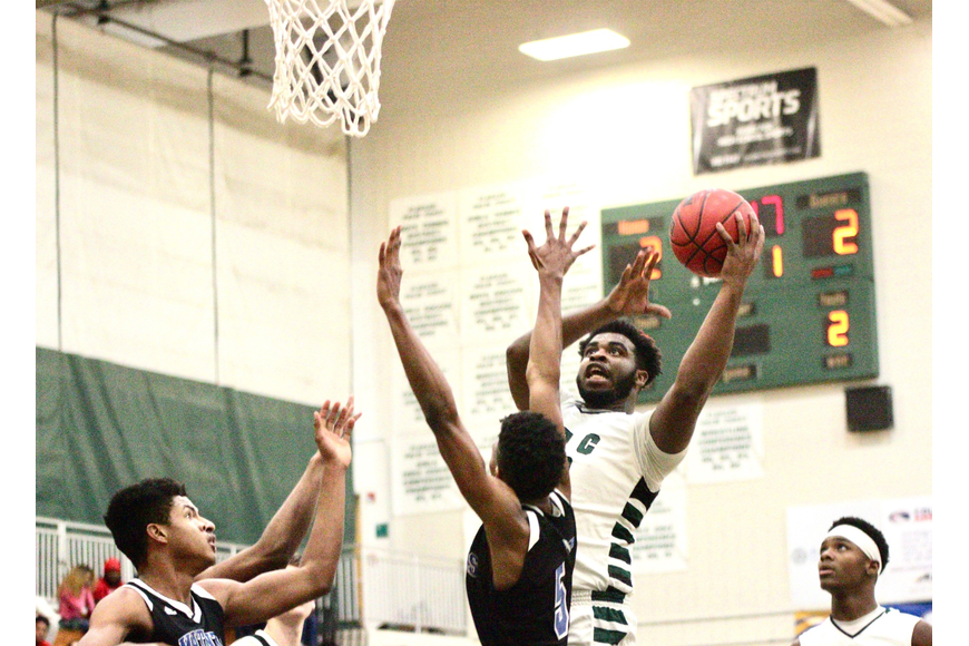 FPC's Dmahgio Warren attempts a layup against the Pirates. Photo by Ray Boone