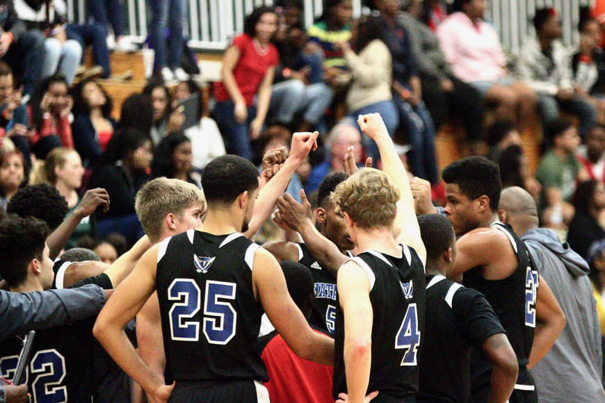 The Matanzas basketball team regroups during a timeout. Photo by Ray Boone