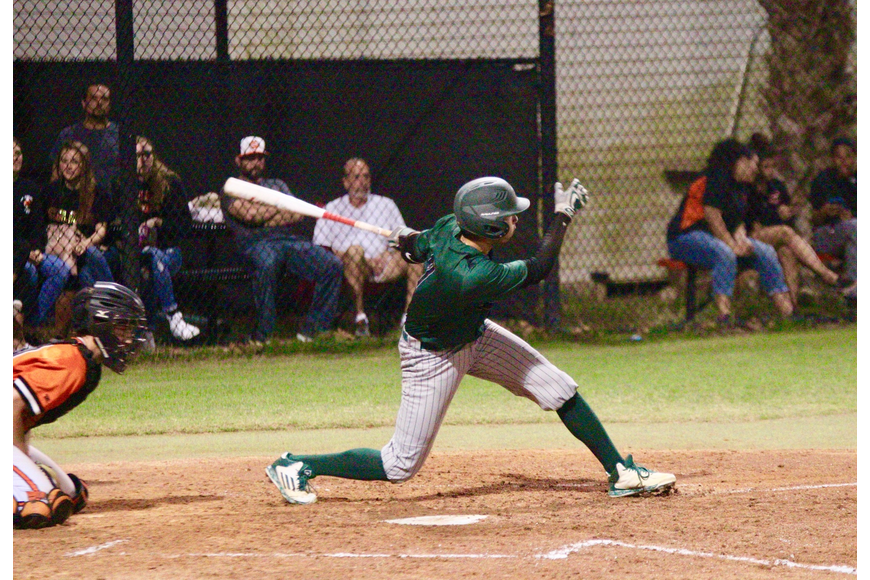 FPC's Cameron Becker connects on a pitch against Spruce Creek. Photo by Ray Boone