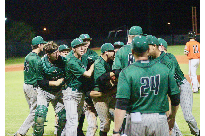 The Bulldogs swarm closing pitcher Trevor Meaney after FPC's win over Spruce Creek. Photo by Ray Boone