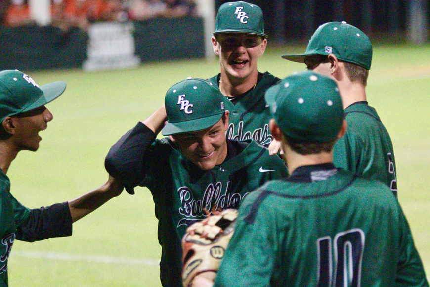 FPC celebrates after a double play. Photo by Ray Boone