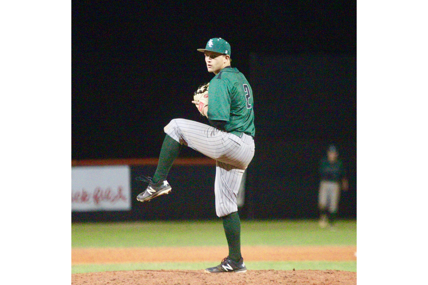 FPC closing pitcher Trevor Meaney winds up to throw against Spruce Creek. Photo by Ray Boone