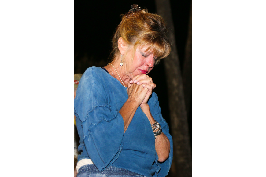 Flagler Beach resident Elizabeth Mailhoit gets emotional during the moment of silence for the 17 victims of the Parkland shooting. Photo by Paige Wilson