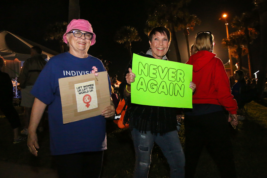 Flagler Beach resident Tess Smith and Palm Coast resident Diana LeBrun march with the students during First Friday. Photo by Paige Wilson