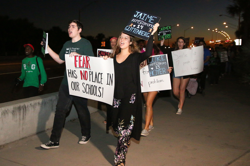 FPCHS SGA President Tyler Perry and SGA member Alyssa Santore lead the march as the group finishes the trek over the bridge. Photo by Paige Wilson