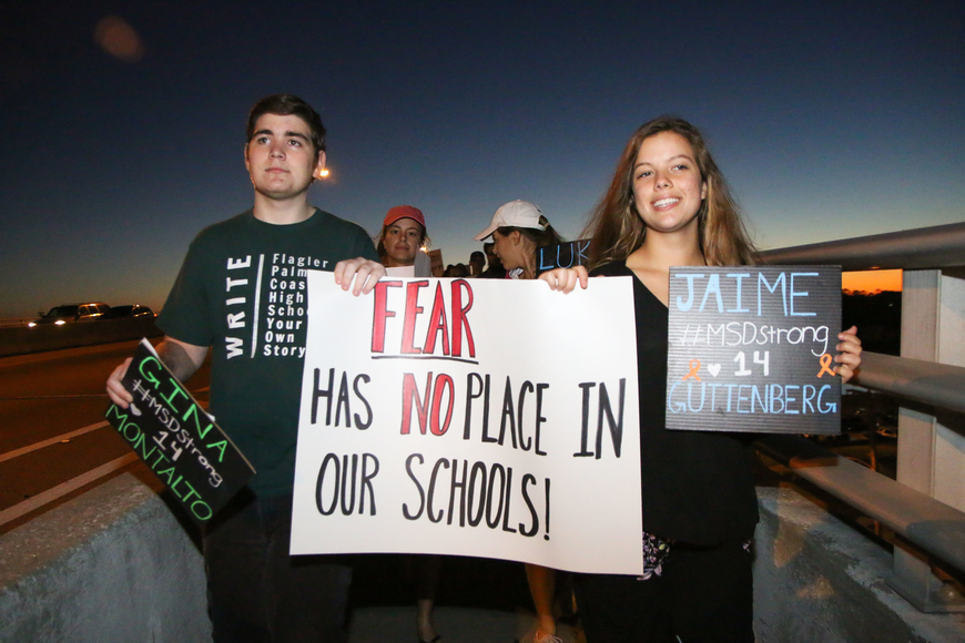 FPCHS SGA President Tyler Perry and SGA member Alyssa Santore lead the march over the bridge. Photo by Paige Wilson