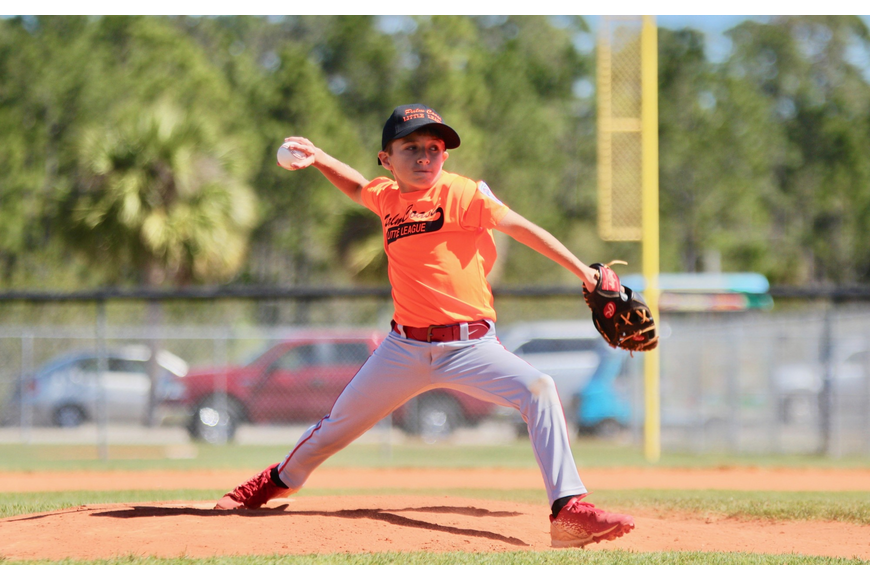 Eleven-year-old Braedyn Wormeck throws a pitch for the Orange Tigers. Photo by Ray Boone