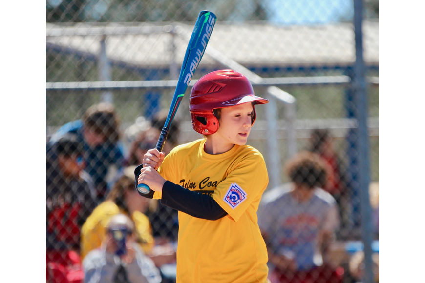 Gabe Graham, 10, takes to the plate during a game. Photo by Ray Boone