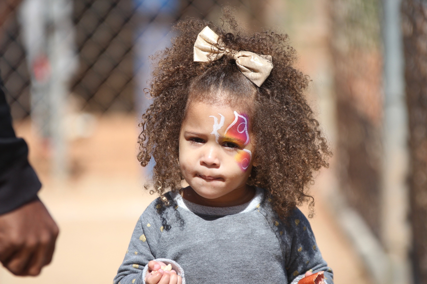 Janae Bass, 2, got a butterfly painted on her face during little league opening day. Photo by Ray Boone