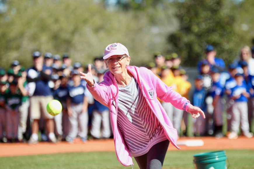 Flagler County Schools' Janet McDonald throws the first pitch at Palm Coast Little League's opening day ceremony. Photo by Ray Boone